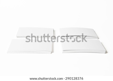 Four Piles of White Horizontal Business Cards with Clipping Path On White Background - stock photo