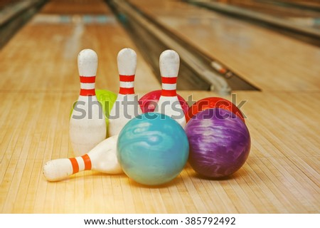 Four pins with five bowling balls - stock photo