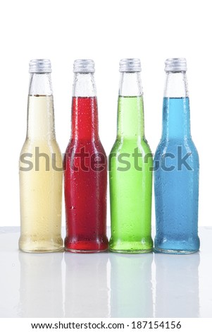 Four pints of beer, of four different colors, isolated on a white background. - stock photo