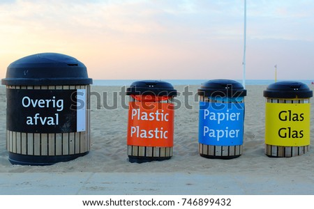 Four Plastic Containers For Trash And Garbage With Words On Dutch Language Wastes