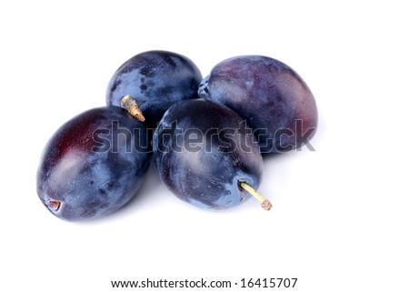 Four plums on white background - stock photo