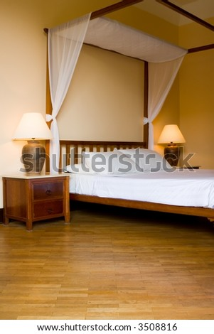 Four poster bed in a resort hotel room - stock photo