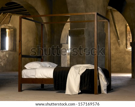 four poster bed inside old historic building