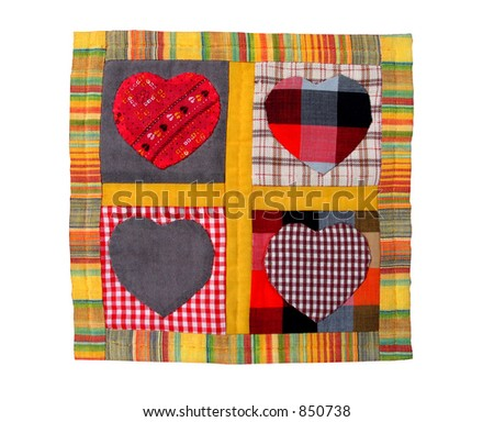 Four quilted hearts - stock photo