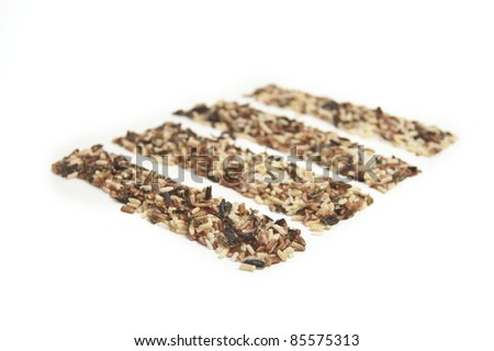 Four rectangular rows of wild rice isolated on white. - stock photo