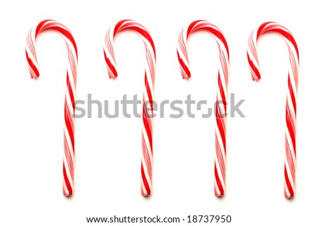 Four red and white Christmas candy canes isolated on white - stock photo