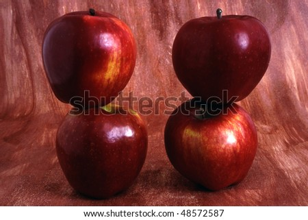 Four Red apples isolated on painted background - stock photo