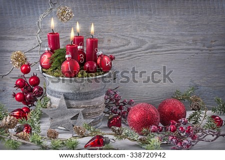 Four red christmas candle for advent - stock photo