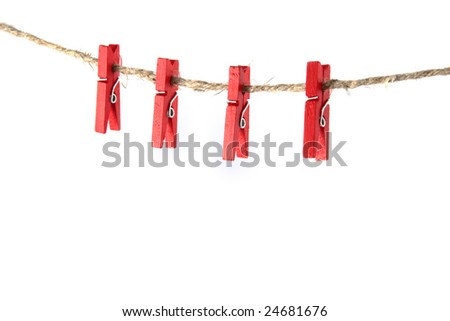Four red clothespins hanging on the old clothesline isolated on white background