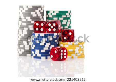 Four  red dice with colored casino chips isolated on white background with reflection - stock photo