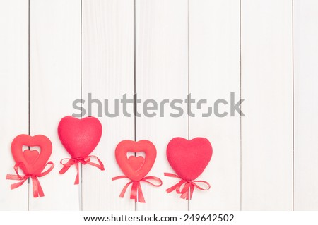 Four red hearts on sticks on a background of wood.Hearts on sticks.Space for text.Valentine's Day.Valentine day.Eighth of March.International Women's Day.Vintage processing. - stock photo
