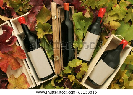 Four red wine gift boxes - stock photo