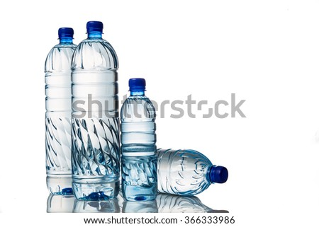 Four refreshing natural mineral water in plastic bottle in white background - stock photo