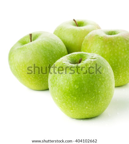 Four ripe green apples. Closeup. Isolated on white - stock photo