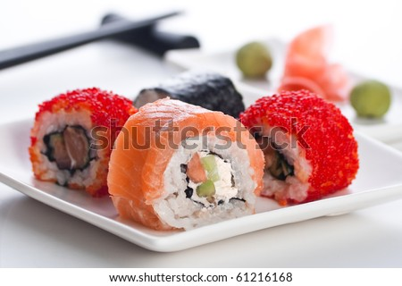 Four roll, wasabi and ginger on the white plate - stock photo