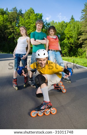 Four rollers at summer park - stock photo