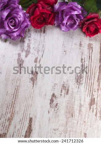 Four roses of different colors on wooden background for Valentine day - stock photo