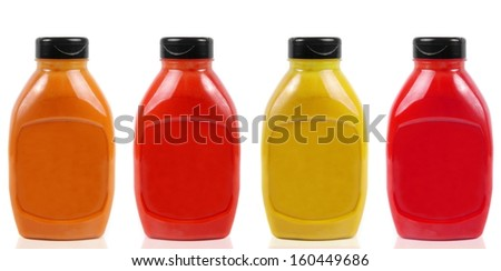 four sauces bottles isolated on white - stock photo