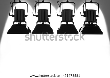 Four  searchlights on a white background.
