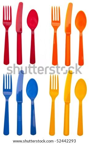 Four Sets of Vibrant Plastic Forks, Knives and Spoons in Red, Orange, Yellow and Blue.  Isolated on White with a Clipping Path. - stock photo
