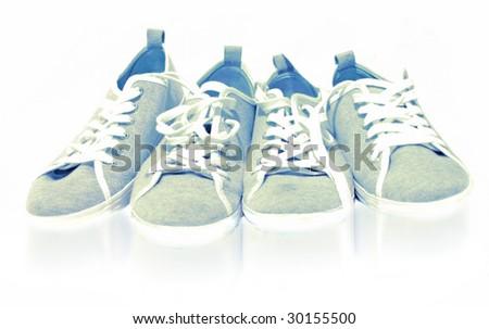 four shoes on white - stock photo