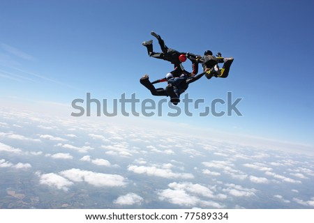 Four skydivers after they have exit an airplane