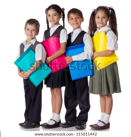 Four smiling schoolchild standing with colorful folders, isolated on white - stock photo