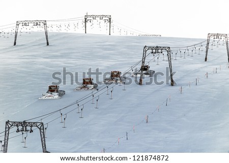 Four snowcats cleaning track on the glacier Kaprun, Austria - stock photo