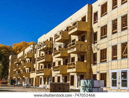 Multi story stock images royalty free images vectors for Building under construction insurance
