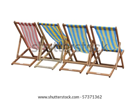 Four striped British deckchairs, isolated on white