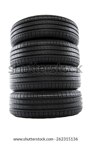 Four summer new car tires ready for season - stock photo