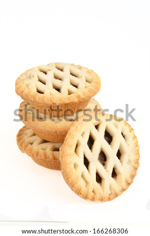 Four Sweet Christmas mince pies isolated on a white background - stock photo