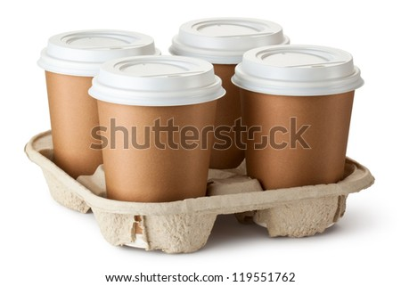 Four take-out coffee in holder. Isolated on a white. - stock photo
