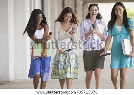 Four teenage walking together - stock photo