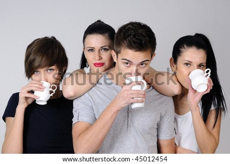 four teenagers drinking - stock photo