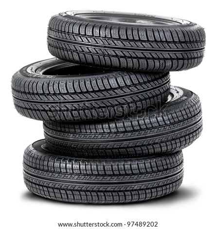 Four tires on the white background - stock photo
