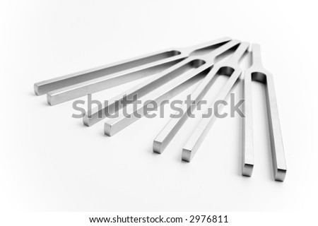 four tuning forks over white background - stock photo