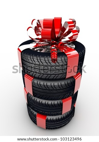 Four tyres with a red ribbon like a present - stock photo
