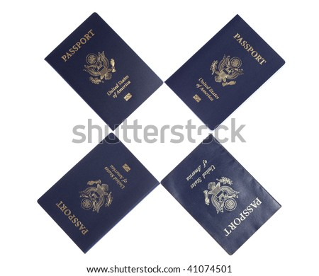 Four US Passports on white isolated background - stock photo