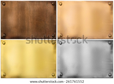 four various metal plates or plaques with rivets isolated on white including silver, brass or gold, bronze and rusty one - stock photo