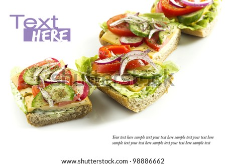 four vegetarian sandwiches isolated on white - stock photo
