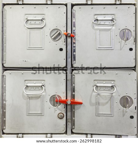 Four vintage aluminum airplane cargo containers used for food storage - stock photo