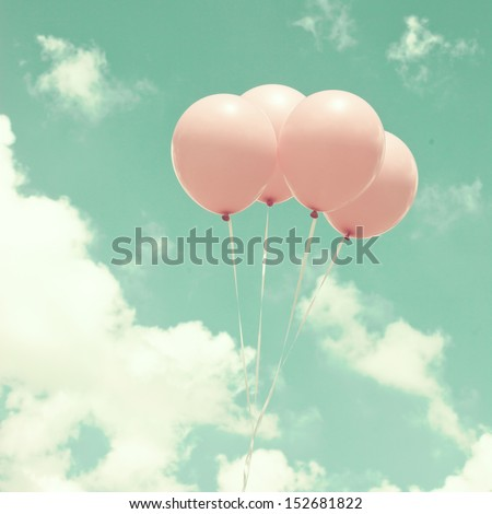 Four Vintage Pink Balloons Over Turquoise Sky - stock photo