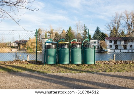 four waste containers for seperating waste at a lake