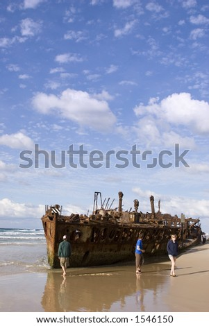 Four-wheel driving travellers check out the Maheno shipwrecks on Fraser Island in Queensland Australia.
