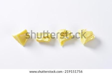 four white chocolate pieces - stock photo