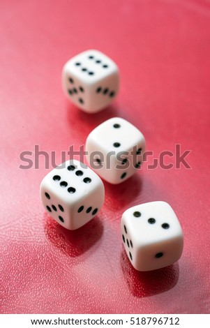 Four white dice on red background