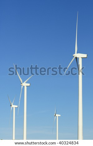 four windmills with clear sky
