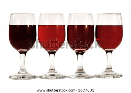 four wine glasses with two clarets, a burgundy and a heavy rose - stock photo