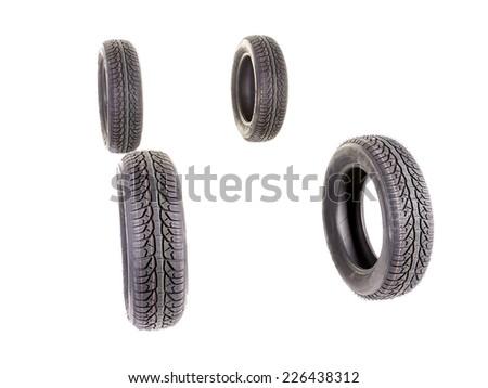 Four winter car tyres shot on white - stock photo